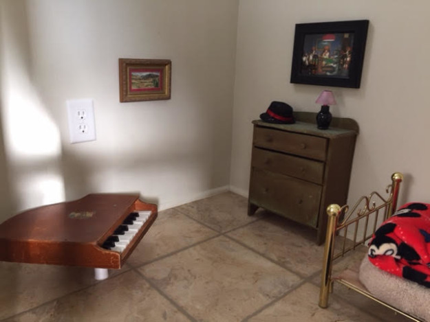 McCall sent BuzzFeed News photos of the other half of the room, which has a TINY GRAND PIANO IN THE CORNER.